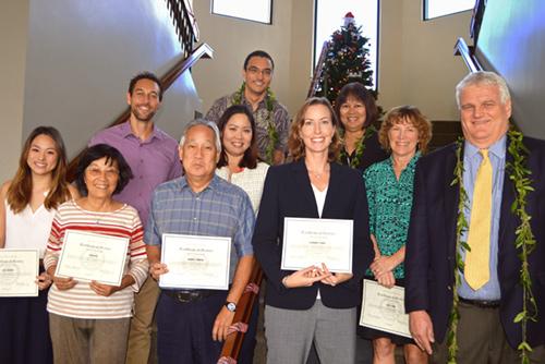 Photograph of Hawaii Chief Justice Mark E. Recktenwald congratulating volunteer attorneys in Kauai.