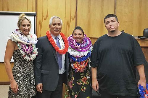 Judge Melvin Fujino with three Drug Court graduates in the Kona Drug Court courtroom, 05/07/18.