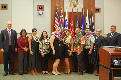 Associate Justice Michael Wilson, Judge Kathleen Watanabe, Chief Judge Randal Valenciano, and Deputy Chief Judge Michael Soong with six graduates of the Kauai Drug Court Program, in front of the 5th Circuit courtroom bench, 05/18/2018.